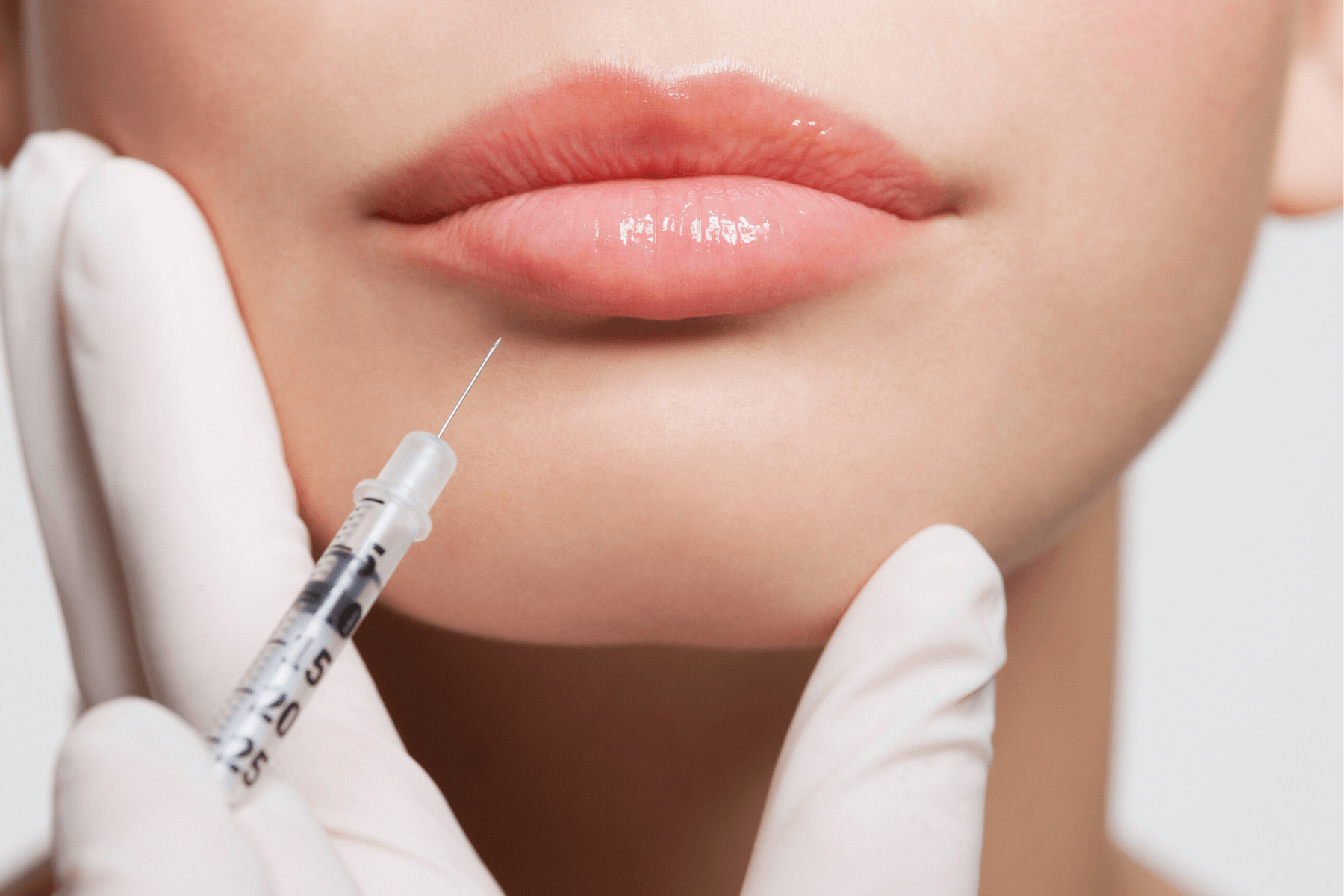 Close up of lip filler with injection certification