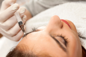 Close up of a woman receiving forehead Botox injections