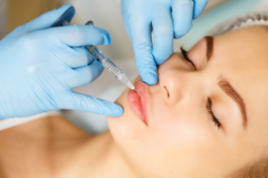 Close up of a patient receiving lip injections through hands-on training