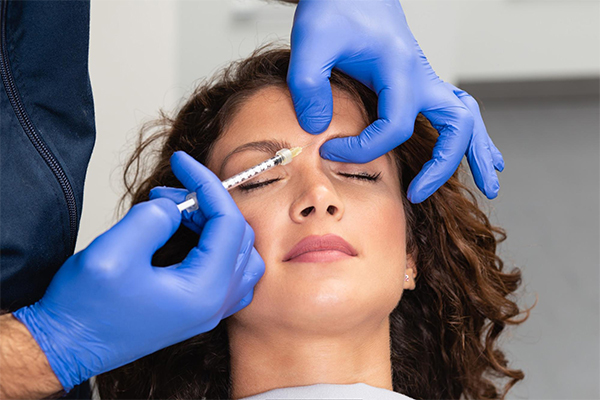 Woman getting a Botox injection in a med spa