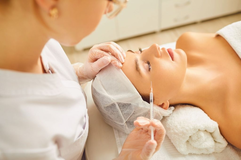 A woman receives Botox injections