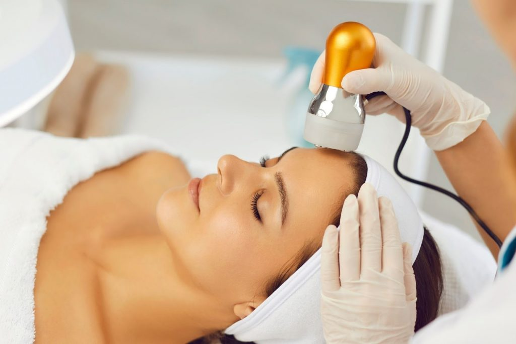 A woman receiving an Ultherapy treatment