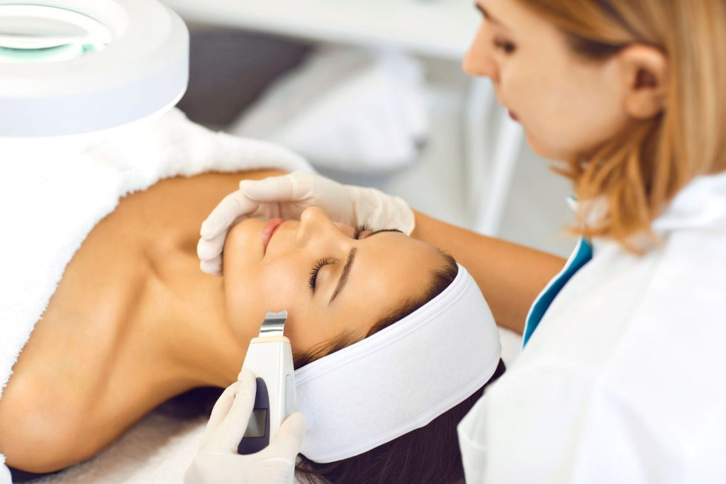 A woman receiving laser therapy