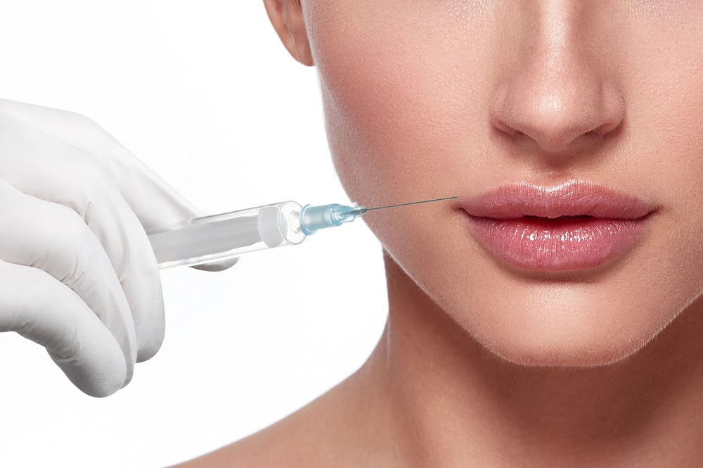 Woman getting a cosmetic injection treatment