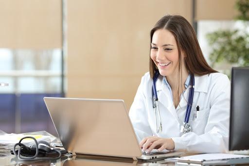 Female doctor taking medical aesthetics training online.